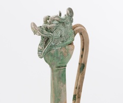 Icon is the dragon head of a ewer found in the shipwreck.